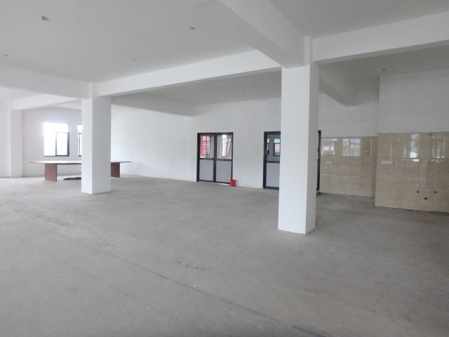 Soon to be in use large & expansive vocational training centre, with washing facilities for felt-making and such to the right.