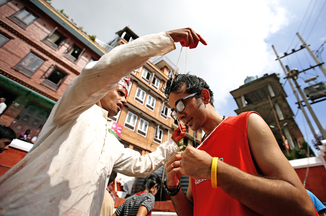 A devotee receiving janai, a sacred thread, during Janai Purnima festival in Lalitpur. Photo credit: Skanda Gautam, Himalayan Times