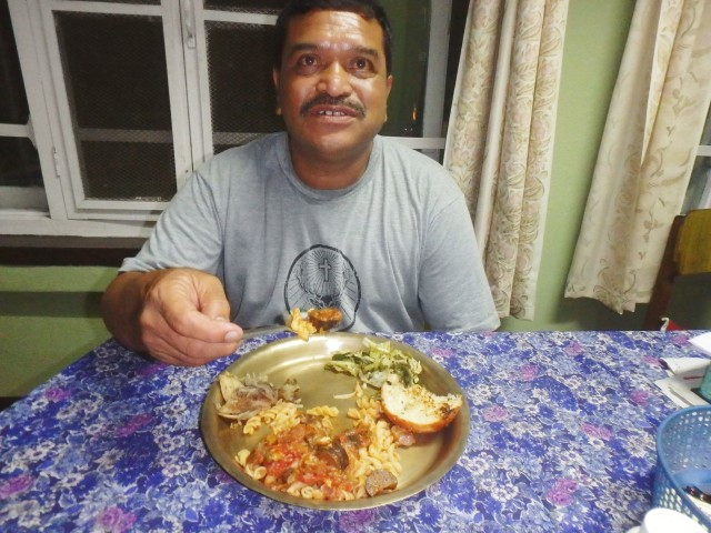 Lok enjoying his first Italian meal at home in Banepa