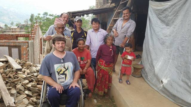 Tom Haig (l) pictured here visiting this family of three disabled people who are building a fully-functional wheelchair-friendly house high up in the Himalayas. Photo Credit Tom Haig.