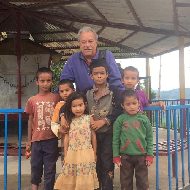 Dr Stan with village kids. Photo credit Dr Stan Ducharme.