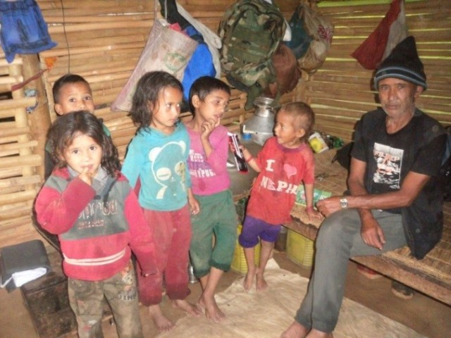 Shambhu Khadka with his two children (plus three more neighbourhood kids in for a look!). Photo credit Prajwal Ghimire
