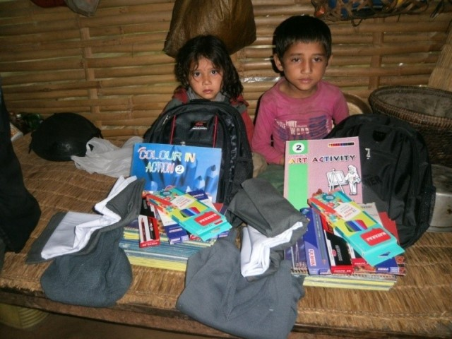 The two other (unrelated) Khadka children aged 8 and 6 years old with their school books, stationery and uniforms in advance of the school year.  Photo credit Prajwal Ghimire.