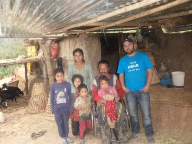 Tika Bahadur Pandey with his family, Prajwal is in the blue t-shirt on the right. Photo credit Prajwal Ghimire.