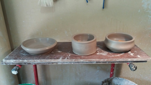 The results of my work! The middle one was my first attempt and is a flower pot (that's my story and I am sticking to it. I made the small plate second and the bowl on the right third 0 they did not turn out too bad!