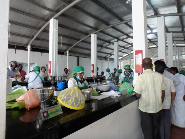 A view of the multiple cooking and food preparation stations at the Food Centre.