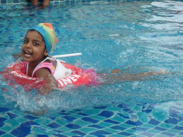Aleena, age 3 getting the hang of swimming.