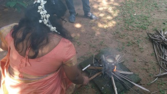 The fire wasn't taking too well so Gayathri took over