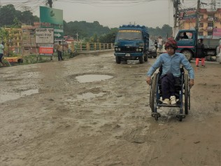 Sidhant on his way to school on the main road in Jorpati
