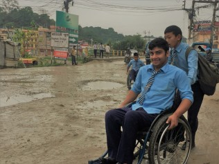 Subash getting some help along the same stretch of road